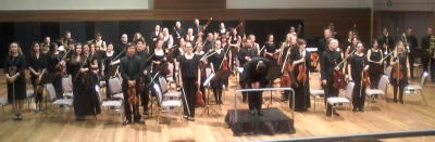 Sarah-Grace Williams, Artistic Director and Chief Conductor of the Metropolitan Orchestra takes a bow